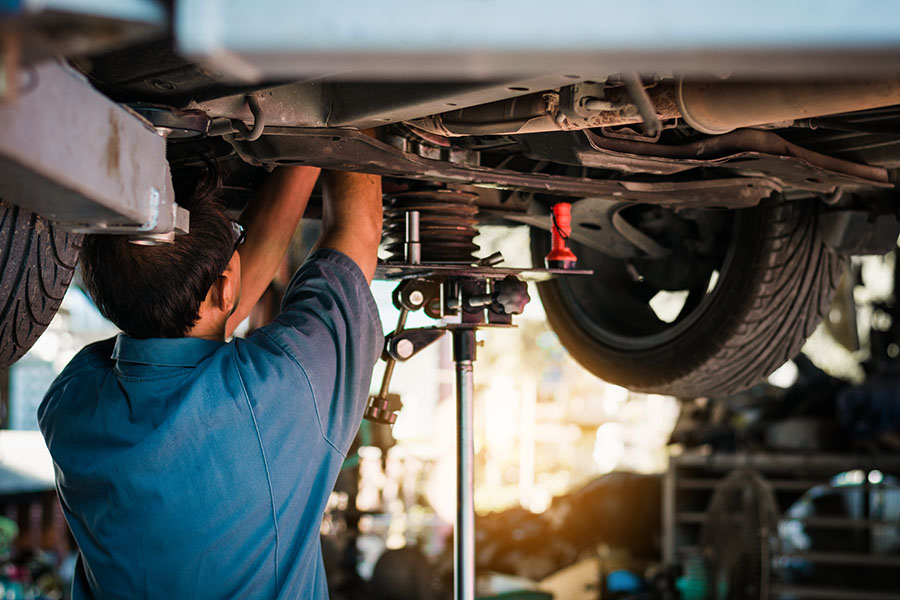 Specialized Business Insurance - Mechanic At Garage Repair Shop Working On Car Repair