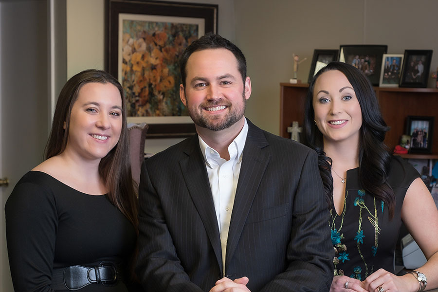 Meet Our Team - Portrait Of Agency Owner Charles Paterson And Employees